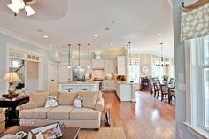 open floor plan. Gorgeous space and light. Love the soft blue walls as well.