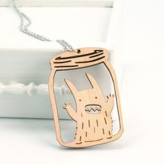 Rabbit Monster necklace by Nia May (via monsterthreads.com). Laser cut wood jewellery = awesome! :)