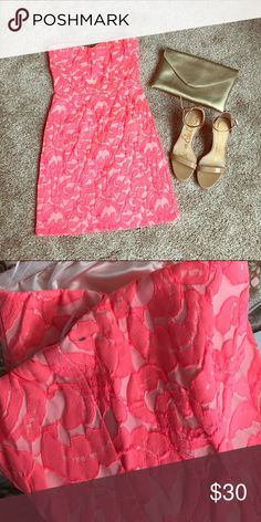 Neon pink brocade lace strapless dress No tags but never worn. I brought it on vacation last summer but didn't end up wearing it. There is a small mark as shown in the picture that would probably come out with cleaning. Fully lined, Zip up back with some stretch. Eight Sixty Dresses Strapless
