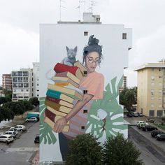 "Artez has just finished another mural in Europe called ""Bookworm"". This mural is located in Zona 167 of Lecce. The idea behind this mural is promotion of education and knowledge – two things that can help us to constantly keep developing. You can lose your cup of tea, but never drop the knowledge that you're carrying! #Streetart #Artez #Education #Murals #Bookworm #Lecce #AllPublicArt"