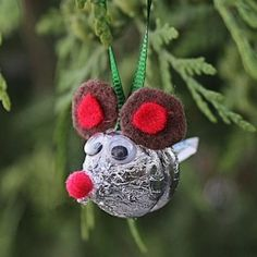Learn how to make cute ornaments using 2 candy Kisses!