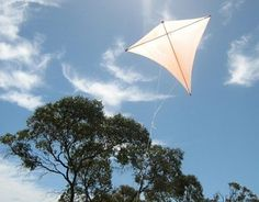 Here's the original Dowel Diamond kite in flight. The lower 2 edges are cut perfectly straight, but take a slight curve under the pressures of flight. It was a perfect day for it - sunny, with very light winds. If thicker dowels are used, this design is fine in moderate to fresh winds.