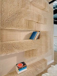 Cosy Home Interior Yellowtrace peg wall bookcase by Elizabeth Whittaker, Merge Architects.