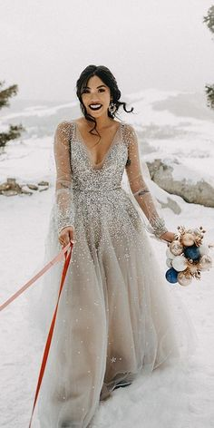 24 Winter Wedding Dresses & Outfits is part of Wedding dress outfit - We have compiled a few amazing winter wedding dresses and outfits to get you inspired Brides wear gorgeous fur jackets, which look very stylish on photos Silver Wedding Gowns, Wedding Gold, Wedding Bride, Gown Wedding, Illusion Wedding Dresses, Grey Wedding Dresses, Silver Weddings, Colored Wedding Dress, Silver Gown