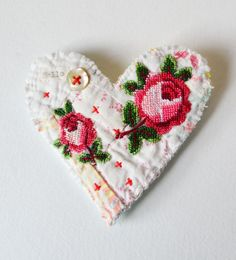 Hensteeth - BROOCH Textile heart shaped.  Appliquéd rose trims. Hand stitched.