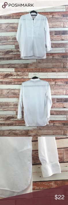 """gap textured henley tunic blouse shirt top beautiful white color tunic. 1/2 front buttoning and panel. high low style. hits below the waist for a tunic look. that makes it great with some leggings or very flattering with some dark wash jeans. 100% cotton. so perfect for spring!   armpit to armpit=19.5"""" length=27""""  no trades. no modeling. send me an offer. don't be shy. 🛍🎉 GAP Tops Tunics"""