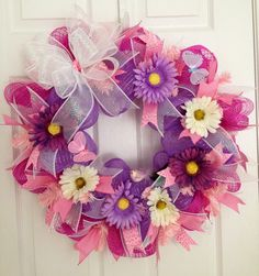 Pink and lavender deco mesh wreath complete with bird and butterfly!