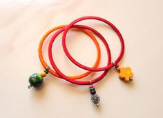 http://www.afday.com/products/red-orange-charm-bangles