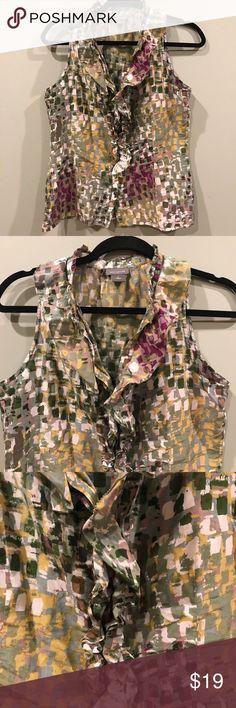 Ann Taylor Sleeveless Ruffle V Neck Top Size 8 Gently used. Super cute Ann Taylor Sleeveless Top. 65% Cotton 35% silk. Ann Taylor Tops
