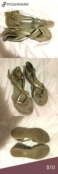 Metallic Taupe Blowfish Sandals Super cute criss cross sandals. Has two buckles on the side for adjusting. In really good condition other than the foot marks and some peeling on the back right heel at the top as shown in the picture. Blowfish Shoes Sandals