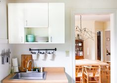 Jess uses wall-mounted storage to solve the lack of storage in her small kitchen.