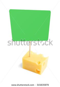 Piece of a cheese with green blank cardboard information tag, isolated on white