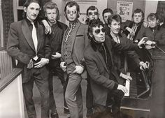 Image of teddy boys in 1950s. Playing music, Adwarian Period fashion for men, browline glasses. I think they look so cute.