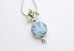 Untitled by Joan Nelson, Larimar i think - love this stone