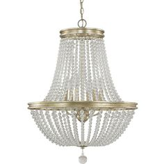 Showcasing an iced gold finish and glass bead accents, this eye-catching chandelier mount casts a warm glow over your entryway or dining room.