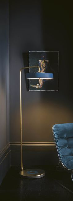 Bert Frank | Revolve Floor Lamp by Bert Frank with a blur lampshade and a golden body.