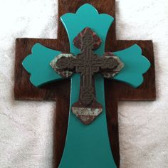 Four layer cross using cowhide, decoupage, painted glaze and metal crosses.   Connie's Creations