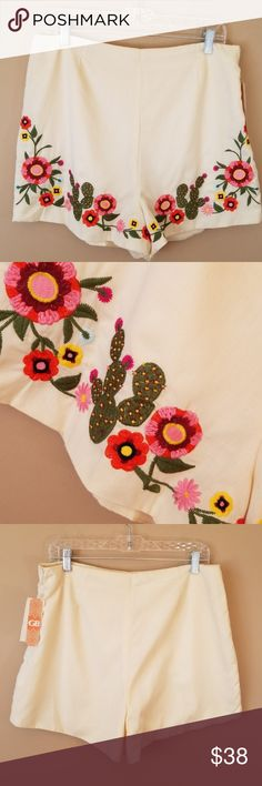 "GB Dillard's XL zip side embroidered western short Waist measure 16.5"" Length 17"" Inseam 2"" GB Dillard's sz XL NWT    Festival season zip on the side embroidered with cactus and floral design Western style shorts! New with tags beautiful ivory cream color shorts the embroider colors are green Orange pink brick red and yellow!  Thank you for visiting my closet I carry many sizes and styles most NWT GB Dillard's Shorts"