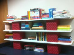 """My husband's solution when I needed bookshelves in my classroom. Fabric covered cinder blocks (8"""" x 8"""") with shelves on top. Way cute and smart!"""