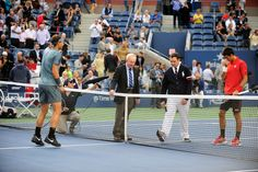 Rod Laver does the coin toss ahead of the 2013 US Open men's singles final between Rafael Nadal and Novak Djokovic. - Andrew Ong/usopen.org