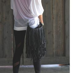 Channel your inner hippie chick with this Btocha fringe style purse from Steve Madden. A free spirited feel with adjustable, chain link hardware and detailed stitching finish the look. Features a top