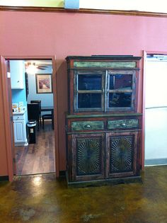 B & J Seafood in Hammond, LA filled up their warehouse store with furniture from Discoveries. Here is a beautiful & colorful carved & painted hutch.