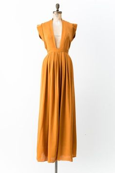 - Overview - Care - Shipping - DESCRIPTION: Marigold Isabel Marant silk sleeveless gown with plunging neck, pleated accents at skirt and tie closure at back waist. CONDITION: EXCELLENT. Light wear. He