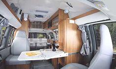 Roadtrek 170-Popular class B motorhome interior - seating and table arrangement