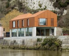 Riverside house by Sandy Rendel Architects contrasts weathering steel with concrete and glass