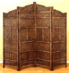 Cairo Screen Indian rosewood room divider which is intricately carved.