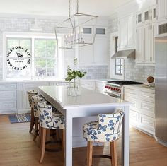 White kitchen with blue accents.