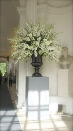 Weddbook is a content discovery engine mostly specialized on wedding concept. You can collect images, videos or articles you discovered  organize them, add your own ideas to your collections and share with other people | Striking white delphinium for altar