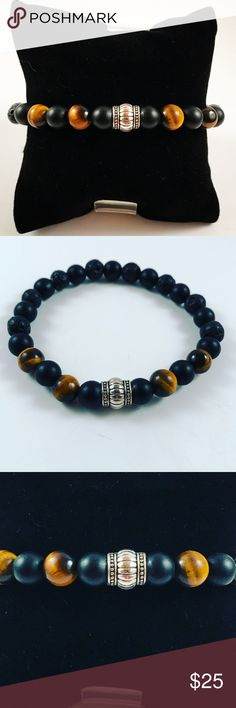 Men tiger eye and onyx beaded bracelet Mem beaded bracelet. Fits most , 7.5 to 8.5 inch wrist. Handmade by me , never worn by anyone. Made with onyx and tiger eye beads. Tibetan silver charm. I ship fast!!✈️ Accessories Jewelry