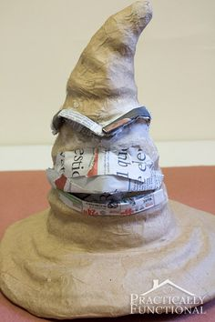 DIY Harry Potter Sorting Hat: Turn a plain paper mâché hat into a sorting hat ., DIY and Crafts, DIY Harry Potter Sorting Hat: Turn a plain paper mâché hat into a sorting hat with newspaper, modeling paste, and paint FOR THE TREE TOPPER! Harry Potter Halloween, Harry Potter Diy, Harry Potter Sombrero, Deco Noel Harry Potter, Magie Harry Potter, Harry Potter Fiesta, Harry Potter Sorting Hat, Harry Potter Classroom, Theme Harry Potter