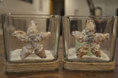 Beautiful and unique glass square candle holders that can be used with either a votive candle or tealight candle. The candle holder has jute roping around the bottom with small seashells done in a starfish design. The candle holders measure approx. 3 1/4 wide and 3 1/4 high. These would be perfect to add to wedding table centerpieces, the guest book table, cake table, use as wedding favors, or for your own home décor. The seashells vary in white, cream, tan, brown and gray color. Each piece…