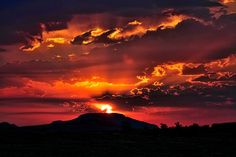 A deep red sunrise over Mt Scott, Oklahoma has so much diverse beauty and landscapes! Photo by Larry Smith (Flickr)