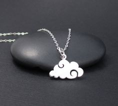 Fun little necklace featuring a tiny sterling silver cloud charm and sterling silver chain. The charm measures 3/8 high without rings x 5/8 wide at the widest point. It is attached to a delicate 1.3mm sterling silver flat cable chain with a permanently closed ring. The chain features a sterling silver spring ring clasp closure and it is .925 hallmarked. Chain length: 16,18 or 20. The wire and all other metal components on this necklace are all solid .925 sterling silver as well. Gift box…