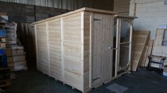 Bespoke Handmade Rabbit Shed at a size of 8ftx4x6.5ft with a walk in run connected to the side at a size of 8x4x6.5ft.  Handcrafted by Boyles Pet Housing