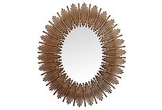 A fresh take on the classic sunburst, this oval mirror is framed in iron and finished in dark gold. It was designed exclusively for One Kings Lane in a style.