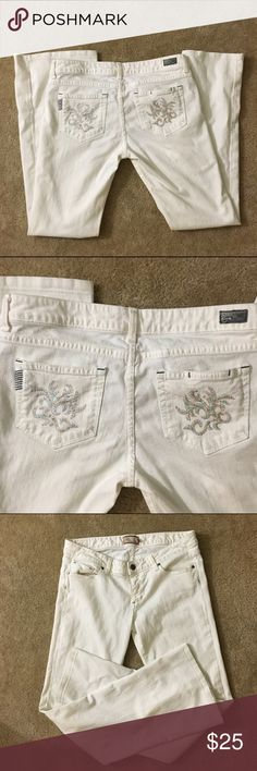 Paige Laurel Canyon Denim Jeans White Sz 31 Paige White Denim Jeans w Multicolor Detail Sz 31. Light blue staining on waist band. Some small staining on back bottom hems.  Some missing thread and snags on left back pocket All defects are shown in pics. Otherwise cute jeans! Paige Jeans Jeans