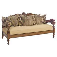 "British Colonial-style sofa with intricately carved framework. Comes with six scatterback pillows and an ultra-down cushion. Product: SofaConstruction Material: Wood and fabricColor: Brown and tanFeatures: Includes seven pillowsDimensions: 42"" H x 80"" W x 41"" D"