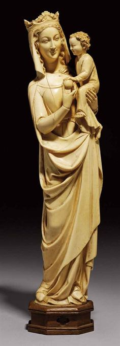 A CARVED IVORY GROUP OF THE VIRGIN AND CHILD - IN THE 14TH CENTURY STYLE, PROBABLY DIEPPE, SECOND HALF 19TH CENTURY