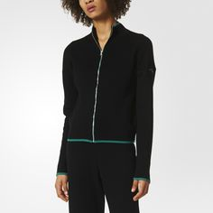 A bold EQT sportswear design meets a feminine silhouette. This women's track jacket pops with a multicolored, multi-texture 3-Stripes block motif that sleekly defines the center back. Up the front, the full zip and high collar are accented with green as are the cuffs and front hem of this all-cotton top.