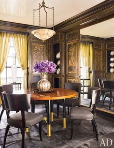 "The elaborate chinoiserie panels in David Kleinberg's Manhattan dining room were installed by a previous owner. ""I would never choose them myself, but it just felt right to keep them,"" Kleinberg says. 