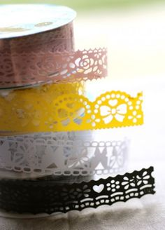Lovely Lace Tape  So pretty, you'll have a hard time choosing just one!    This lovely lace tape peels off the clear film and is a sticker that can be cut to your desired length and placed just about anywhere.    It's perfect for decorating handmade cards, embellishing scrapbook pages, jazzing up a plain notebook, wrapping cute packages (this tape looks great on kraft paper) , decorating a vase or clear container, and so much more!