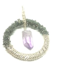 Truly gorgeous handcrafted Raw Dangling Vera Cruz Amethyst in Wrapped Silver Plated Wire Pendant Adorned With Crushed, Sealed Pyrite, almost as if it has been dipped in a twinkling mix of gold and silver pieces, and sealed.  This handmade piece is one of a kind. The crushed pyrite has been hand placed, is very secure, and sealed. However, please do take care when storing and wearing - as with all gemstone jewelry. Showering and submerging in water is not advisable.   PYRITE Primary Chakra…