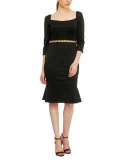 Chunky gold-tone stones add a touch of elegance and drama to this versatile black knee-length dress from Red Couture. With three quarter length sleeves and a square neckline, this midi dress has a simple and chic appeal with a slightly flared hem that creates a trumpet-inspired silhouette.