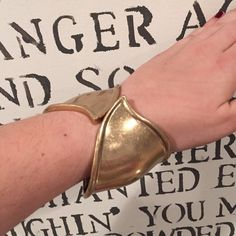 Chico's Joelle wrist cuff A great gold bangle designed to look worn in. Makes you feel like Wonder Woman became a Gladiator in Ancient Rome. Design looks like two leaves wrapping around your wrist. Chico's Jewelry Bracelets