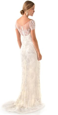 """by Reem Acra - """"The dress"""" should be all about the back. This beauty has vintage charm with pearl and sequin appliqués atop airy tulle, with sweetheart neckline and sheer cap sleeves."""