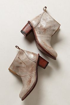 Shop boots for every occasion in The Boot Shop at Anthropologie. Discover unique booties, tall boots, weather boots and more, including the season's newest arrivals. Bootie Boots, Shoe Boots, Ankle Boots, Grey Boots, Women's Boots, Fashion Shoes, Fashion Accessories, Metallic Shoes, Metallic Paint